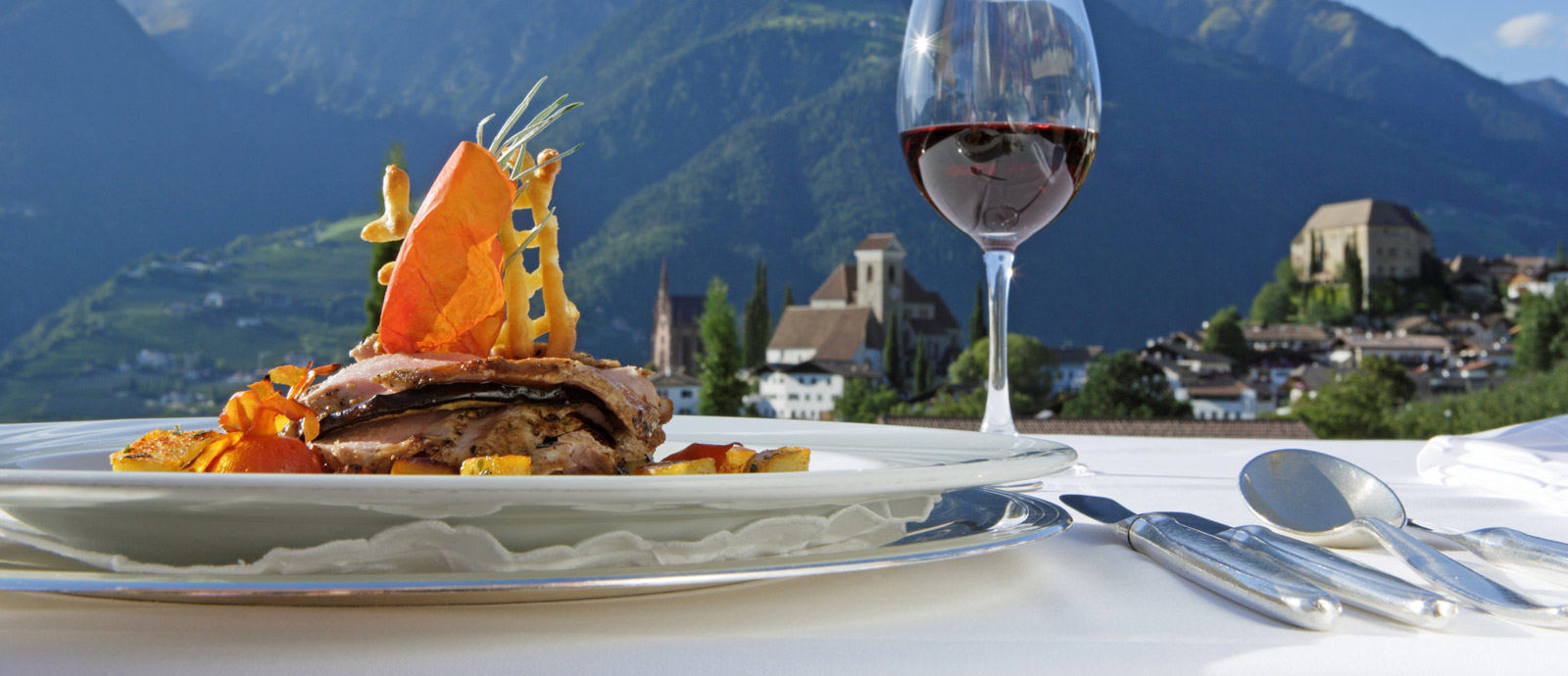 Enjoying gourmet dinner with view to the castle of Schenna, Hotel Hohenwart, Schenna, South Tyrol
